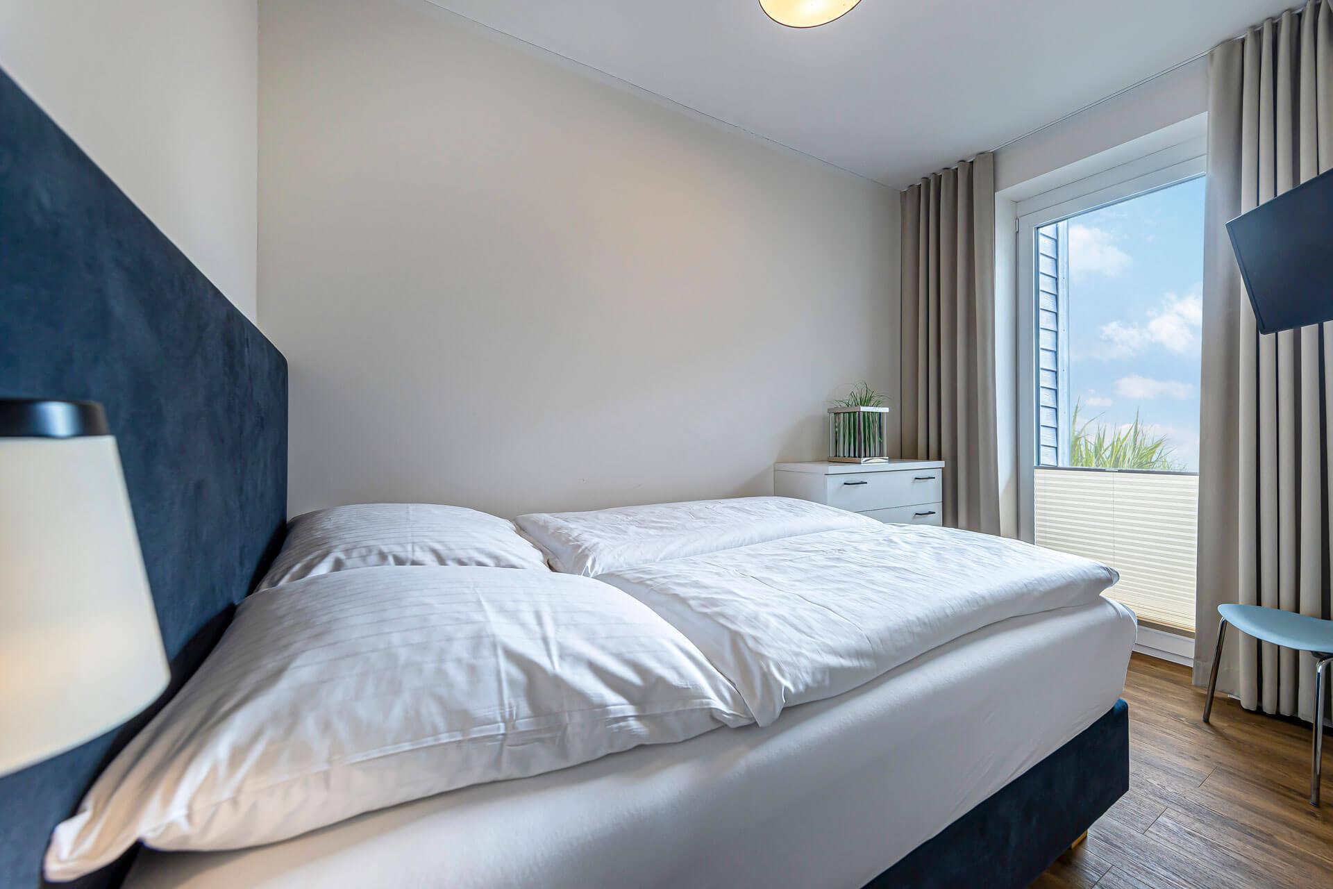 Hotel-Meerzeit-Apartment_Schlafzimmer